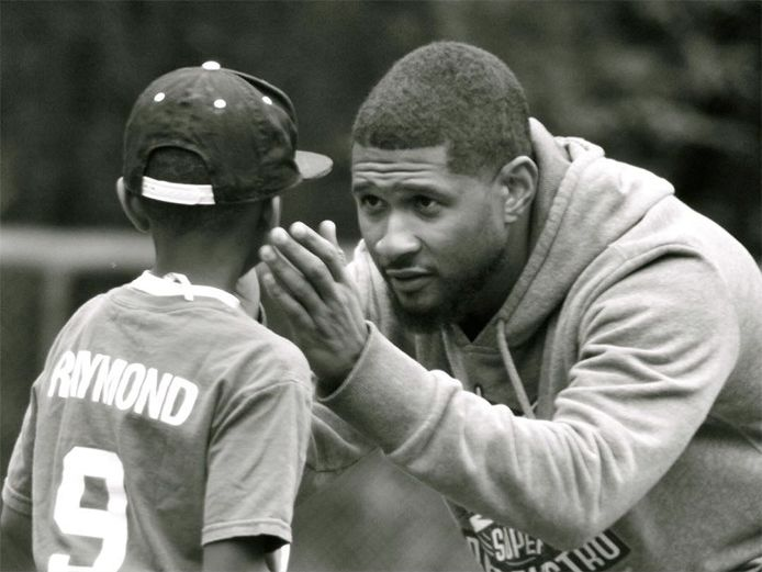 fyeahusheraymond:    Usher at his his son, Usher V's Little League Baseball Game