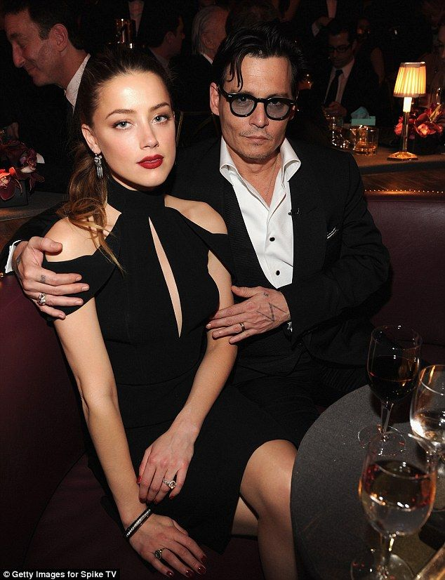 Cold feet? Johnny Depp, 51 and Amber Heard, 28,  - pictured here in May this year - 'put w...