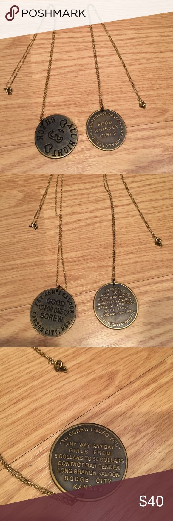 "Two Vintage brothel token necklaces These two necklaces have vintage traditional brothel tokens on them. One necklace says ""All night check $3"" on one side and the other says ""Good for one screw, Fat Anna Salon, Carson City Nevada. The second necklace says ""Food Whiskey Girls, Long Branch Saloon Dodge City Kansas"" and the other side says ""To screw I need you, any way any day girls from 5 dollars to 50 dollars, contact bar tender"". 12in chains. Jewelry Necklaces"