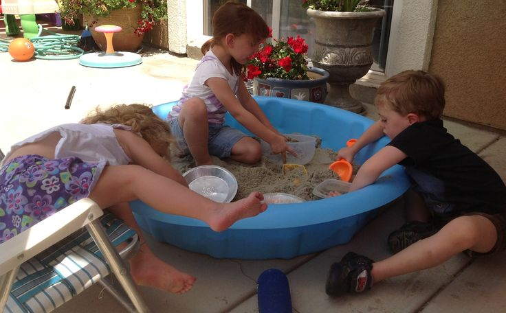 Simple sandbox made from a small swimming pool. Cover the top with a larger plastic kids pool.