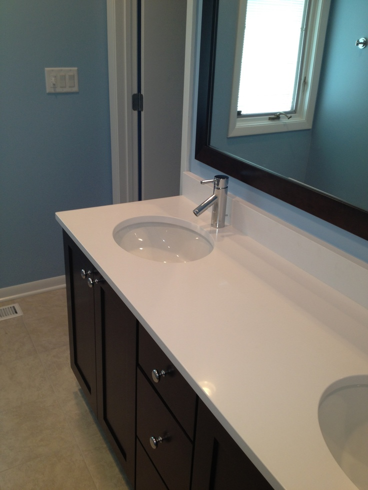 Photographic Gallery Vanity is Wellborn Cabinetry with white silestone countertops