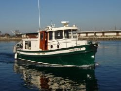 Nordic Tug  32' - love this boat.  This would get us anywhere we wanted to go....even Greenland.