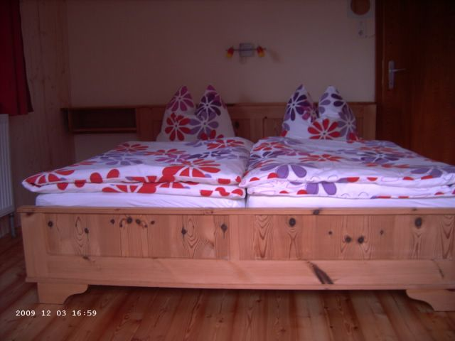 De heerlijke bedden waar U zo lekker tot rust komt in Haus Bergblick