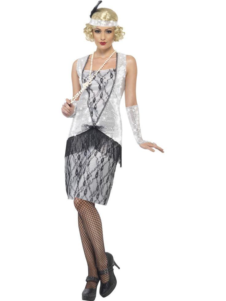 Disfraz plateado de charlestón para mujer: Este disfraz de charlestón color plateado se compone de un gorro, un vestido y un par de mitones a juego.El vestido lleva lentejuelas hasta las caderas. La parte inferior es blanca y...