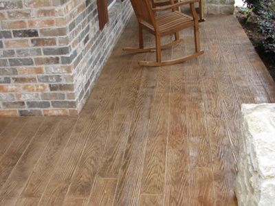 Great site for stamped concrete ideas.  Love the Wood-look concrete for the back porch.  Keller Landscaping