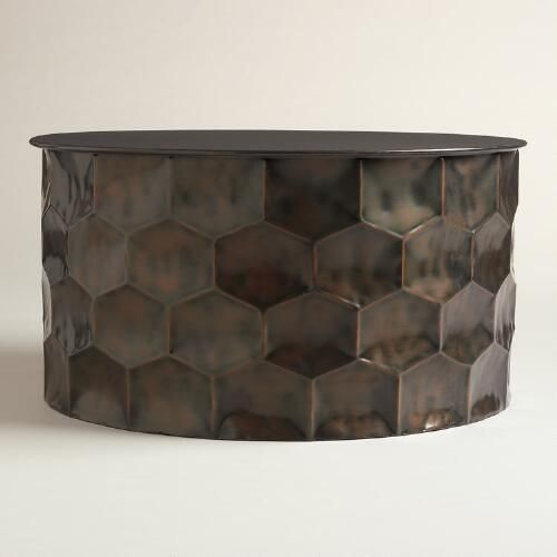 Indian artisans hammer metal to create the unique, on-trend honeycomb design of our drum table. With a removable lid, it's an eclectic coffee table and storage solution in one.