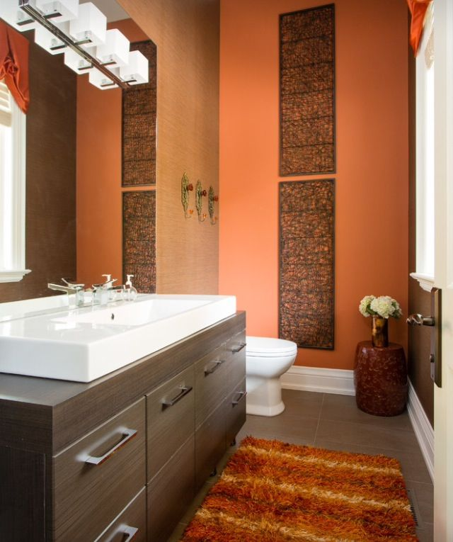 main guest bathroom orange walls brown decor with bits of cream or white spread out