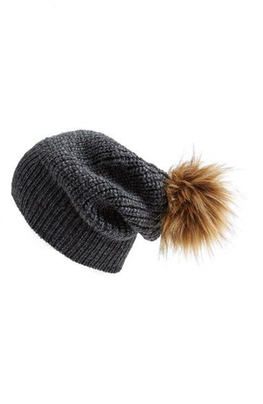 #Nordstrom.  #FreePeople.  Pompom Beanie. Item # 1164784.  $58.  Charcoal (pictured), Oatmeal, and Rosewood.