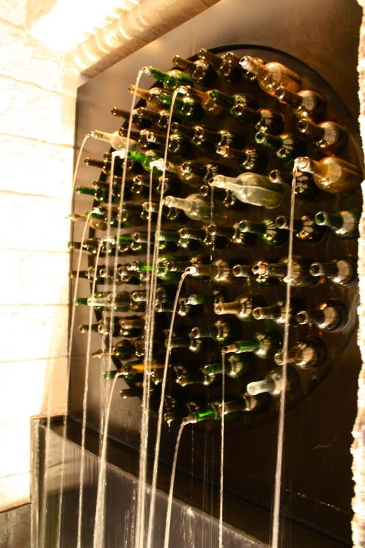 Must make a wine bottle water feature. Think It of using an old wine rack as the structure and sprinkler wands to distribute water into the selected bottled