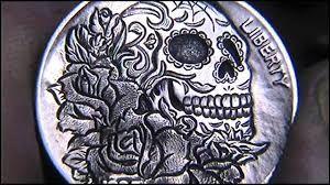 Image result for engraved skull carving
