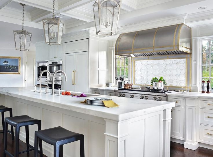 Mixed Metals Of The Appliances And Mercer Lanterns Give