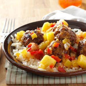 Sweet-Spicy Asian Meatballs Recipe -I love the sweet and spicy flavors of Chinese food and decided to try to incorporate them into a meatball. The subtle tastes of the meatball blend well with the spicy Sriracha and sweet chili sauce. The garam masala adds a hint of coriander, black pepper and cinnamon for a unique and fun flavor. —Darlene Buerger, Peoria, Arizona