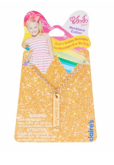 """Show the world you are JoJo Siwa's Number One Fan with this adorable gold pendant message necklace from the JoJo Siwa Collection. The gold pendant is engraved with """"Just Have Fun"""" and the signature JoJo Siwa heart. Pendant is attached to a silver chain with a lobster clasp."""