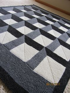 """Afghan Blanket Knitting Pattern: """"A New Angle"""" falling blocks knitting pattern by Woolly Thoughts at Etsy #optical_illusion   Bold Geometric Blanket Knitting Patterns at http://intheloopknitting.com/bold-geometric-blanket-knitting-patterns/"""