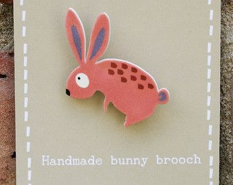 Cute shrink plastic pooch brooch With a metal brooch fastening to the back. Handmade in Clares home studio, this jewellery will add a touch of fun to any clothes, bags or anywhere in need of a little decoration. Over 50% off for a limited time only