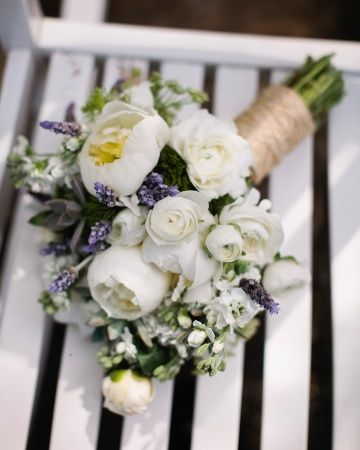 a clutch of freesia, roses, ranunculus, succulents, and lavender by Cachepot