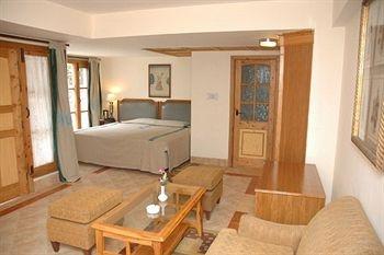 Bedroom in the duplex cottage at marigold shimla