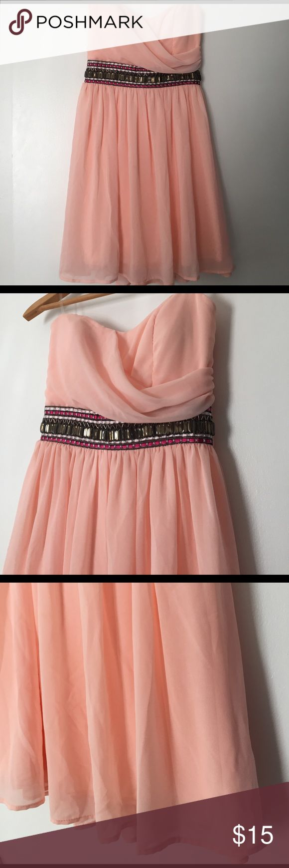 Formal Dress Sweet, girly, fun little formal dress. While this does fall under the formal category, I personally think it can double as a casual Dress by adding a cute little denim jacket over it! Fun details in the dress such as the beading, and the flow-y tulle. Dresses Prom