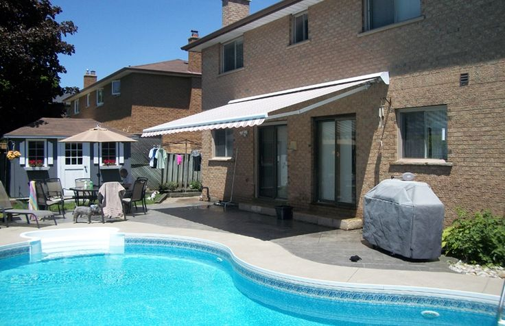 Bright Rolltec awning by the pool #Rolltec #DeckandPatio #awnings #landscaping #swimmingpool