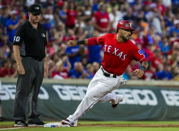 Texas Rangers center fielder Ian Desmond (20) steals third base during the fifth inning of their game against the Houston Astros on Wednesday, June 8, 2016 at Globe Life Park in Arlington, Texas. (Ashley Landis/The Dallas Morning News)