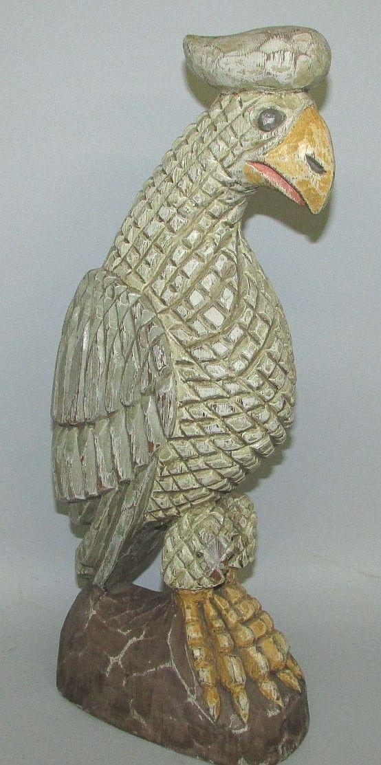 Realized price lot folk art eagle carving