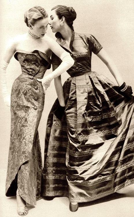 Helen Connor & Myrtle Crawford in metallic brocade evening dresses, Vogue UK, September 1951