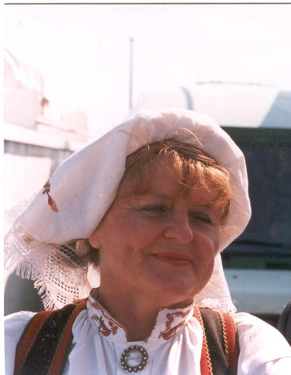 Unusual? Myself in national garb. The headgear shows a married woman. In the olden days in Norway embroidered cloth was the thing when brocades weren't affordable!