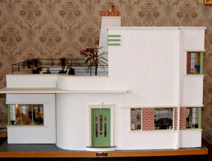 An Art Deco Dolls House made and furnished by Artisans by Jazz -  follow the link to see this house it opens on three sides and has some great rooms