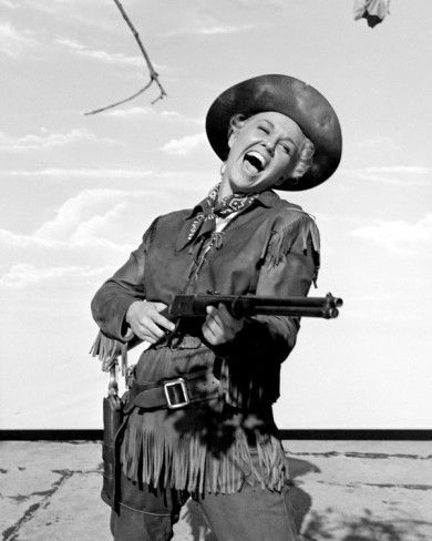 Doris Day - Calamity Jane (1953) As a little girl, my favourite bit was when she took off her big overcoat to reveal her pretty pink dress to the delight of Wild Bill! Love this film.