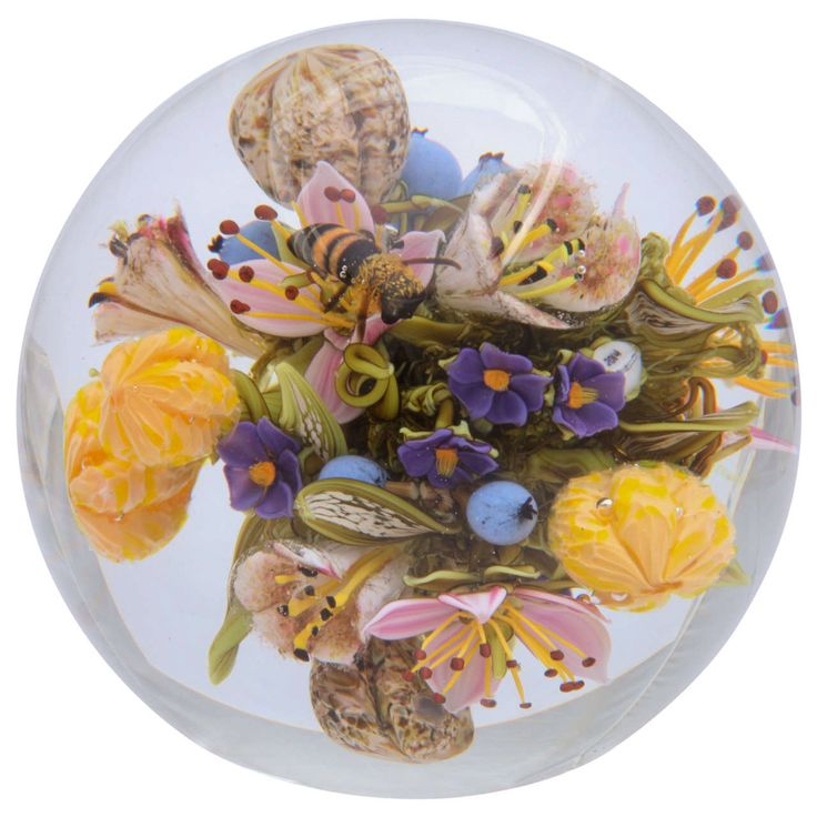 Paperweight by Paul Stankard from his Flower, Fruit and Nut series, with a silhouette cane of Walt Whitman, and a honey bee