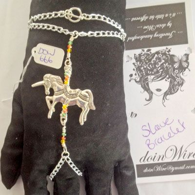 doinWire handcrafted Slave Bracelet. Silver aluminium chain with orange, yellow and green crystals and unicorn charm.  (pic 1of2)  DOW666
