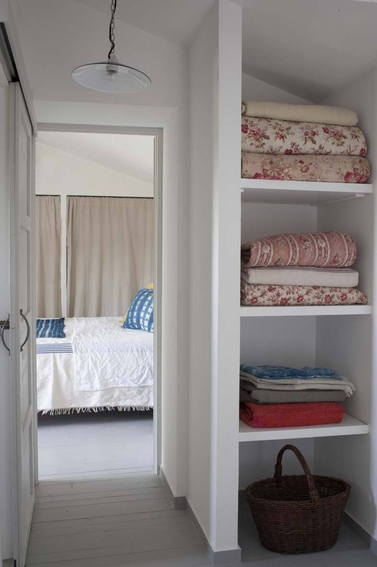 Linen closet with floral quilts at Mas Maroc, Amanda Pays Corbin Bernsen farmhouse in the South of France. Tim Beddow photo from Open House.