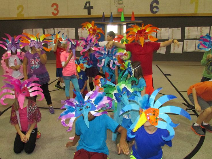 Paper mache Brazilian carnival masks made by my 3rd grade students for their mask parade; lesson by art teacher: Susan Joe