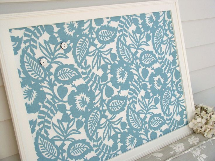 decorate your bulletin board using printed fabric.