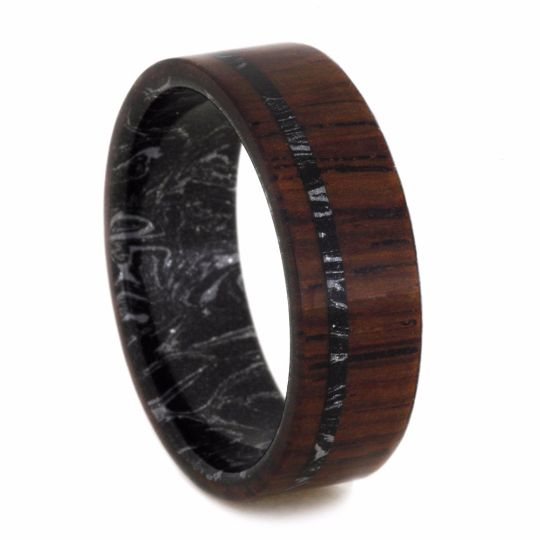 This Honduran rosewood wedding band is made out of mysterious mokume gane with streams of silver ripples swirling in a pool of black. The eye-catching co...