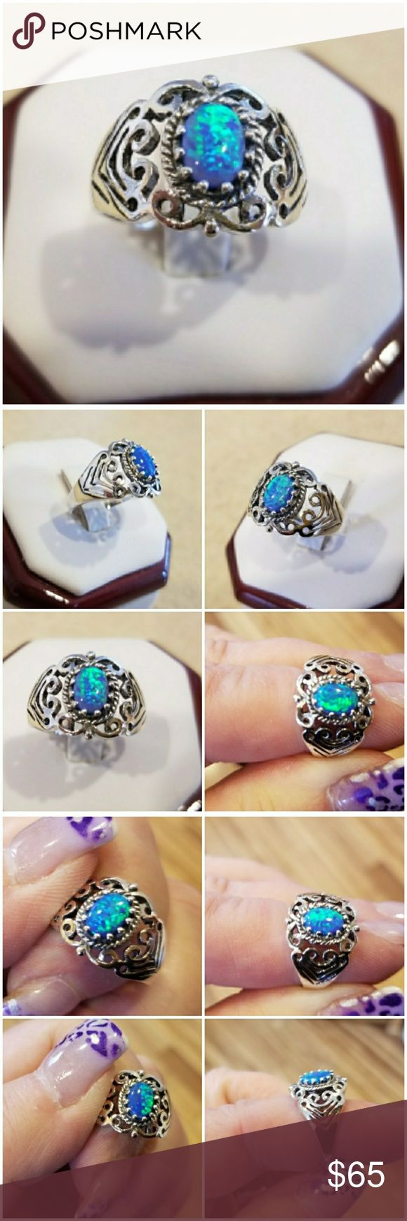 Genuine 2ct Blue Fire Opal Ring Size 7 Beautiful Art Deco Filigree Design!  Set in 925 stamped Solid Sterling Silver. Please see all pictures for more detail. Brand New. Never Worn. WHOLESALE Prices Always!! Jewelry Rings