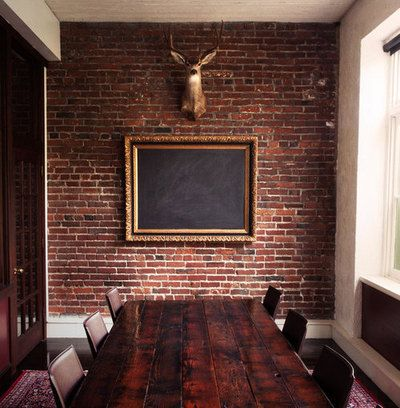 Coolest boardroom.  The mix of brick, ornate frame & blackboard & head.  Brilliant.