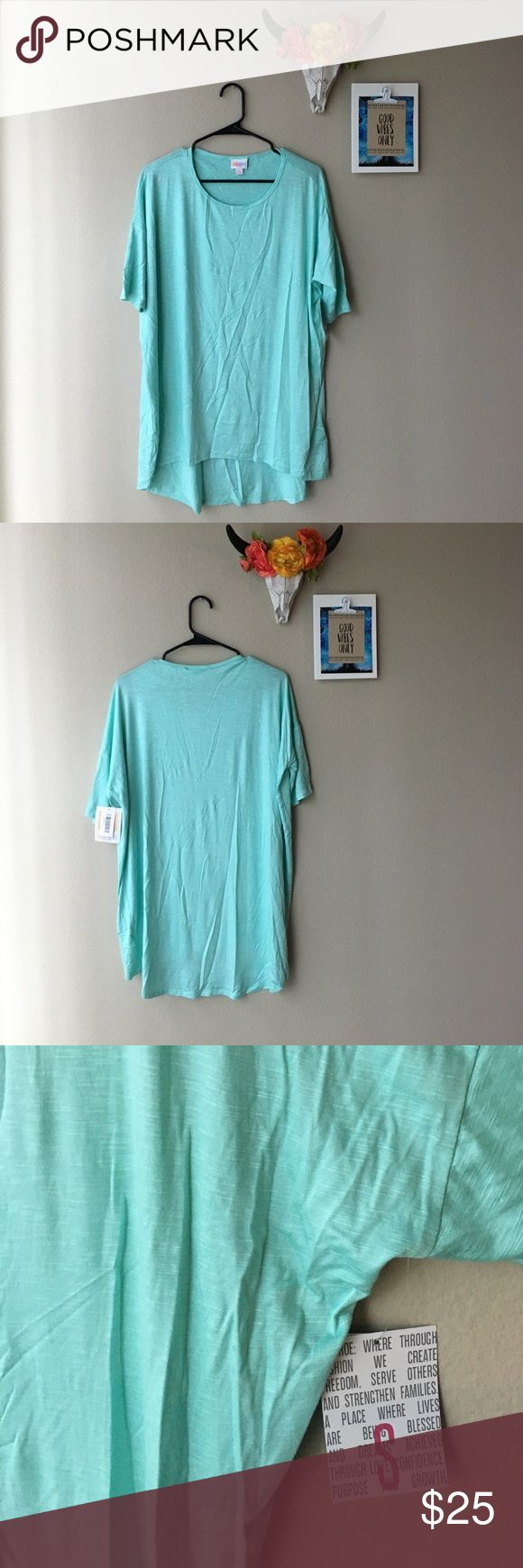 Small mint green top Small mint green lularoe Irma top. Never been worn, nothing wrong with it, just the wrong size. LuLaRoe Tops Tees - Short Sleeve
