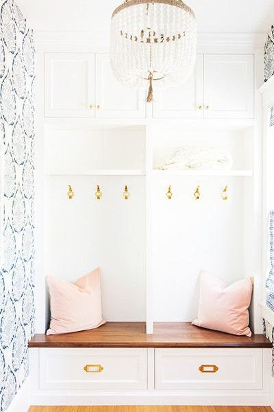 Cute entryway with pastel accents, blue wallpaper print, pink, pearl chandelier
