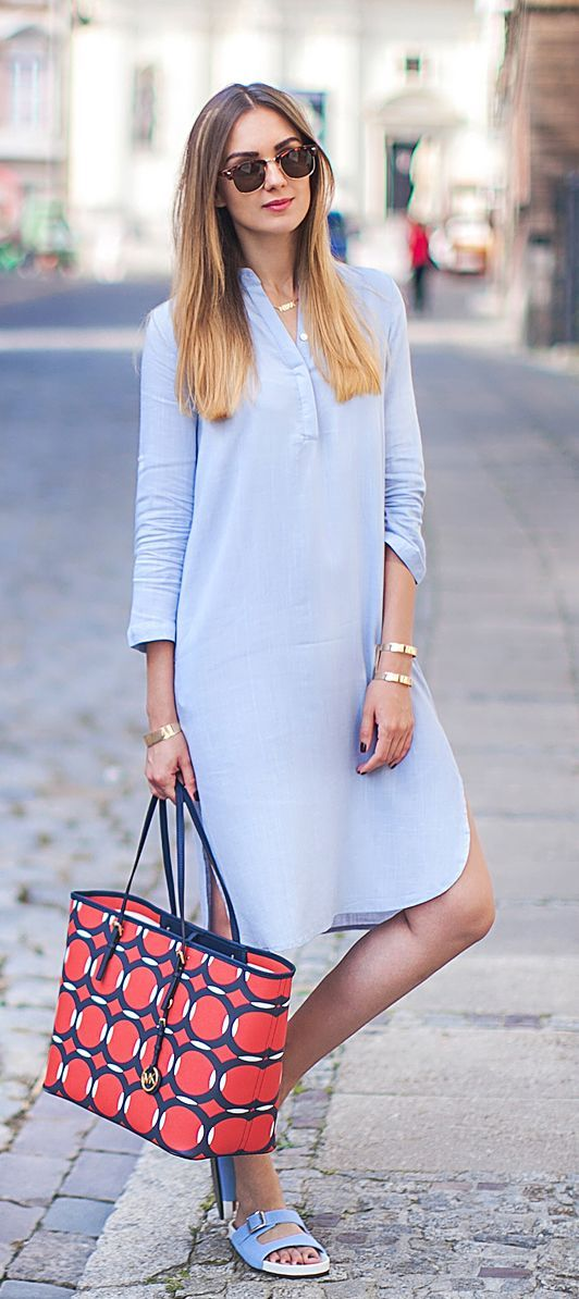 Nika Huk is wearing a light blue shirt dress from ChicNova, matching sliders and sunglasses  from ASOS and a bag from Michael Kors... | Style Inspiration