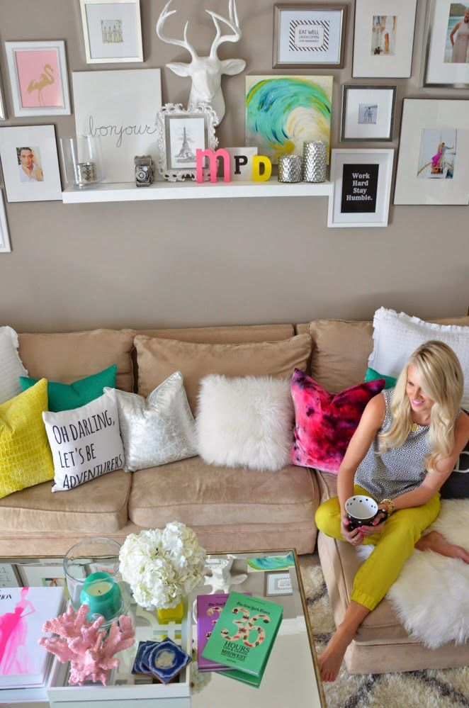 neutral couch with all different colored pillows