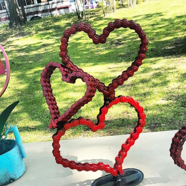 Outdoor Whimsical Metal Heart Garden Yard Sculpture  Recycled Art Artwork garden art ideas Metal Heart made with scrap metal this sculpture stands 5 ft tall x 6 ft across see this and more by Raymond Guest scrap metal Artist at Recycled Salvage Design www.recycledsalvage.com