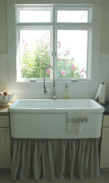 farmhouse sink with dropcloth