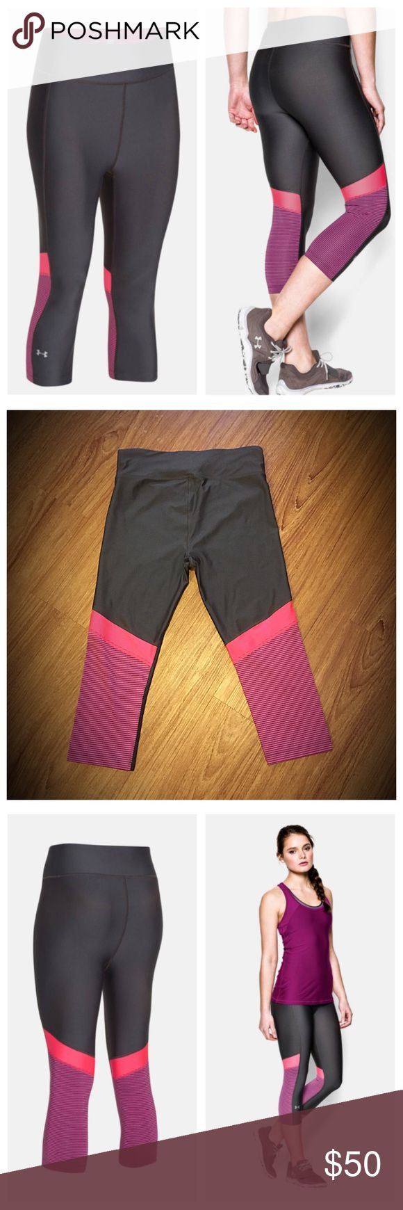 """Under Armour Heatgear gray/purple/neon coral Capri 📦Same day shipping (as long as P.O. is open for business). ❤ Measurements are approximate. Descriptions are accurate to the best of my knowledge.  Ultra tight 2nd skin compression. Light weight moisture wicking 4-way stretch fabric. Anti-microbial technology. 13.5"""" waist, 18.5"""" inseam, 10"""" rise from top of crotch seam. No pilling/holes/stains. See close-up photo of small manufacture defect where section of thread seam is missing (less than…"""