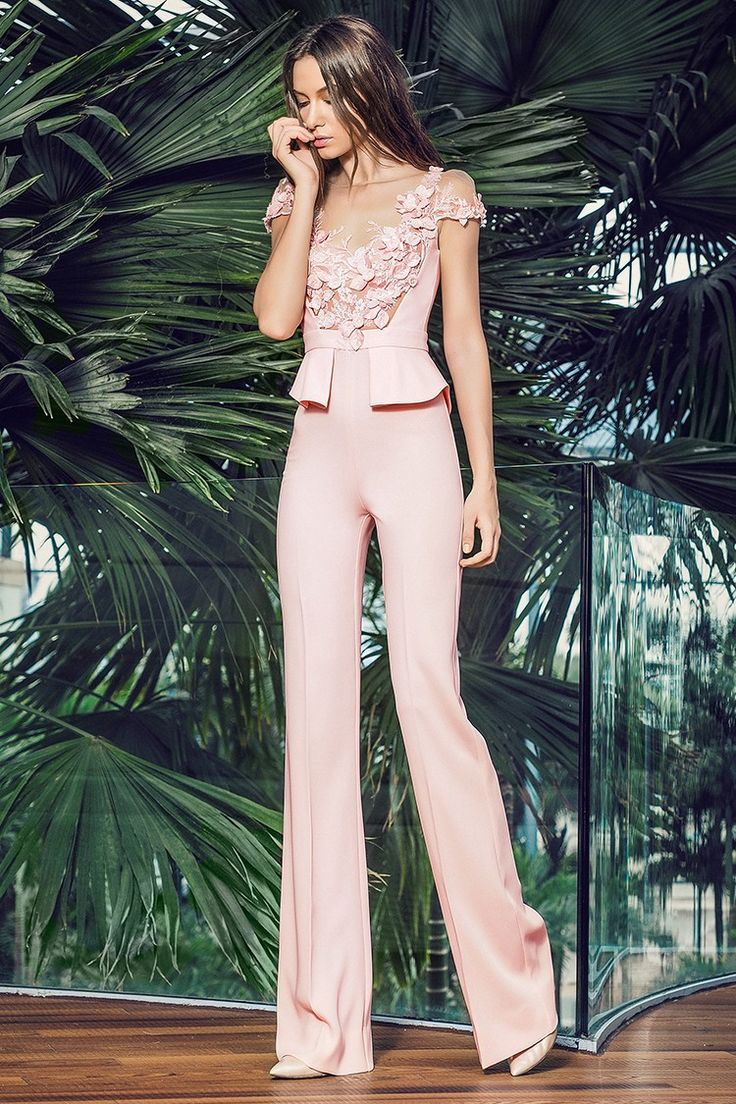 CRISTALLINI JUMPSUIT SKA545 - Stretch-crepe, 3D laser cut flowers applied manually, tulle nude polyamide Partially lined, waistband, incorporated peplum waist Hook and fastenings zip at back Floor-length Dry clean For a personalised touch of unique details, each jumpsuit has slight differences in the cutout of the lace due to the handmade embroidery Shown color: peach
