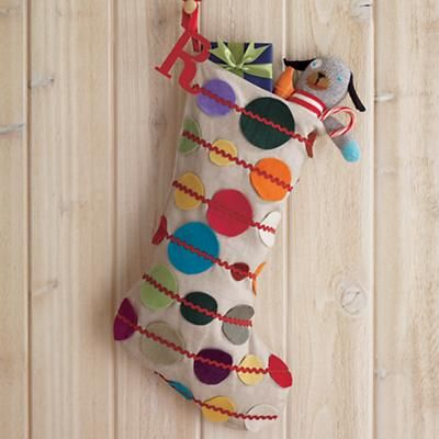 wooden letter hanging off the side of stocking