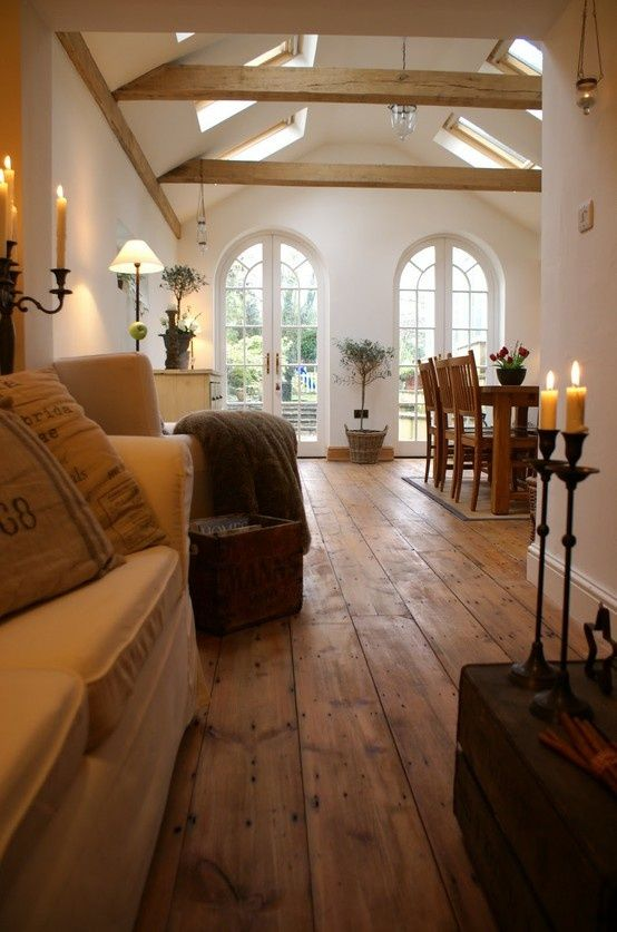Wood flooring is gorgeous with the beams