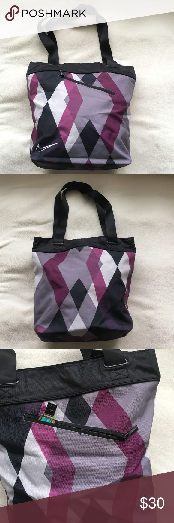 "Nike tote bag Purple and black Nike tote bag. Perfect for those days when going to work, to the gym, to the store transition bag! Fits comfortably over your shoulder and is about 14"" deep and 11"" wide. It is a black and purple color patten. NWOT Never been used. Nike Bags Totes"