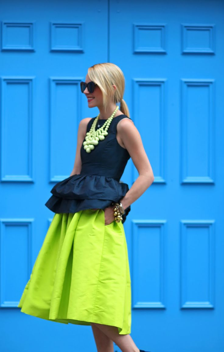 Atlantic-Pacific x BaubleBar. Interestingly beautiful 2 tiered peplum top  with a full neon skirt! The statement necklace is very cool.