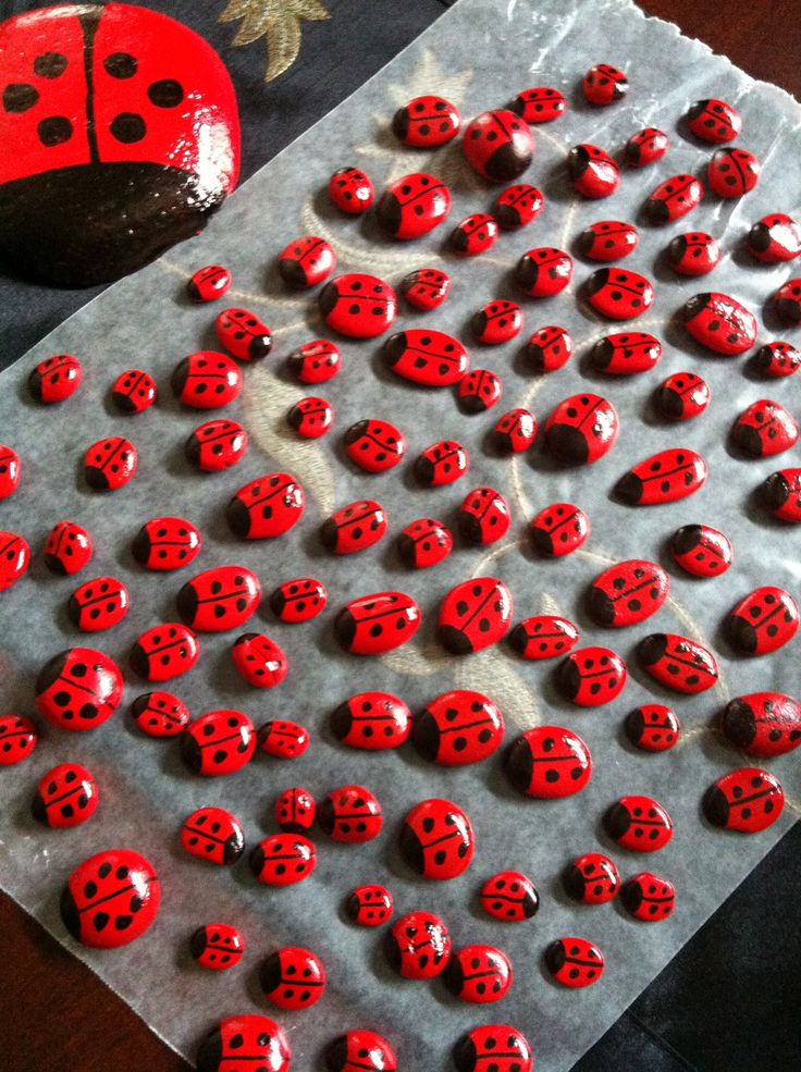Painted ladybug rocks for Geocaching swag.